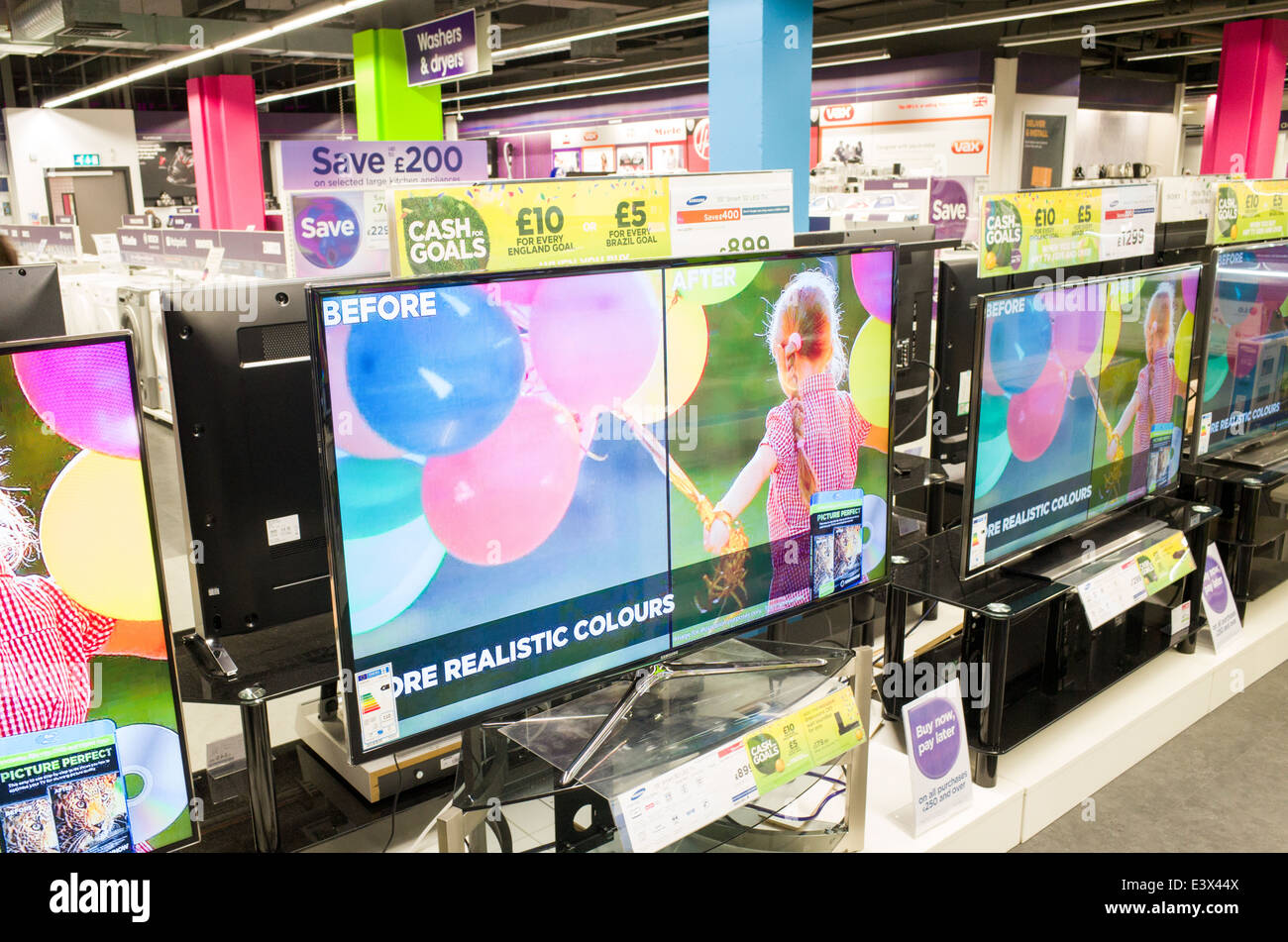 Widescreen televisions for sale at Currys PC World, England, UK - Stock Image
