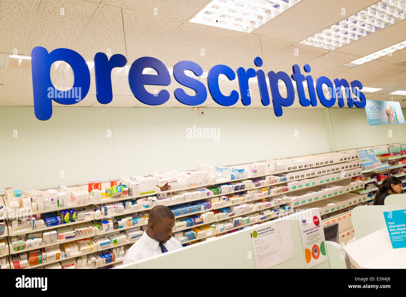 Prescriptions counter at Boots pharmacy, England, UK - Stock Image