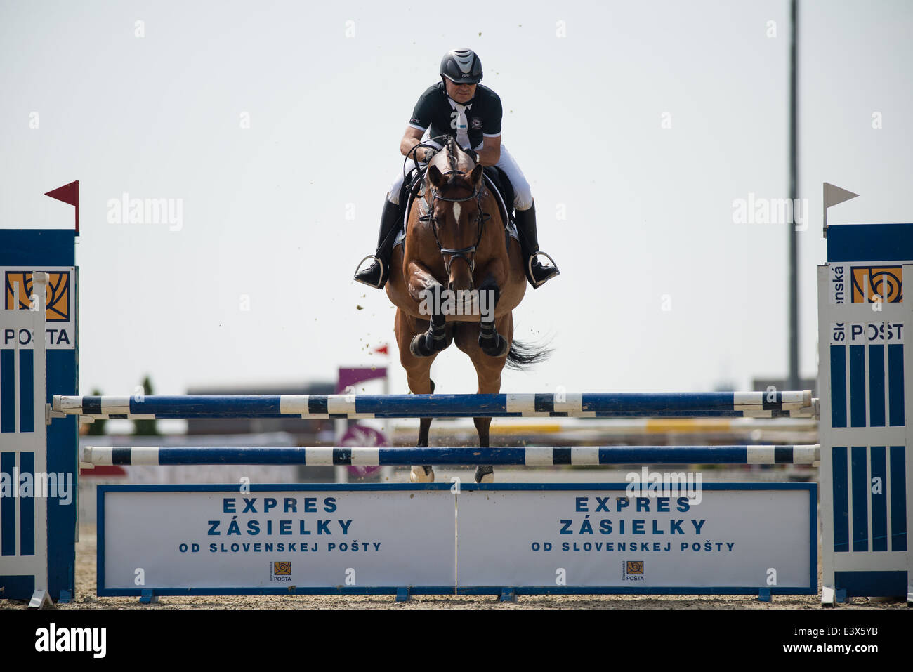 Libor Bittner CZE on horse Alexis 3 jumps over hurdle on Rozalka Cup 2014 on July 29, 2014 in Pezinok, Slovakia - Stock Image