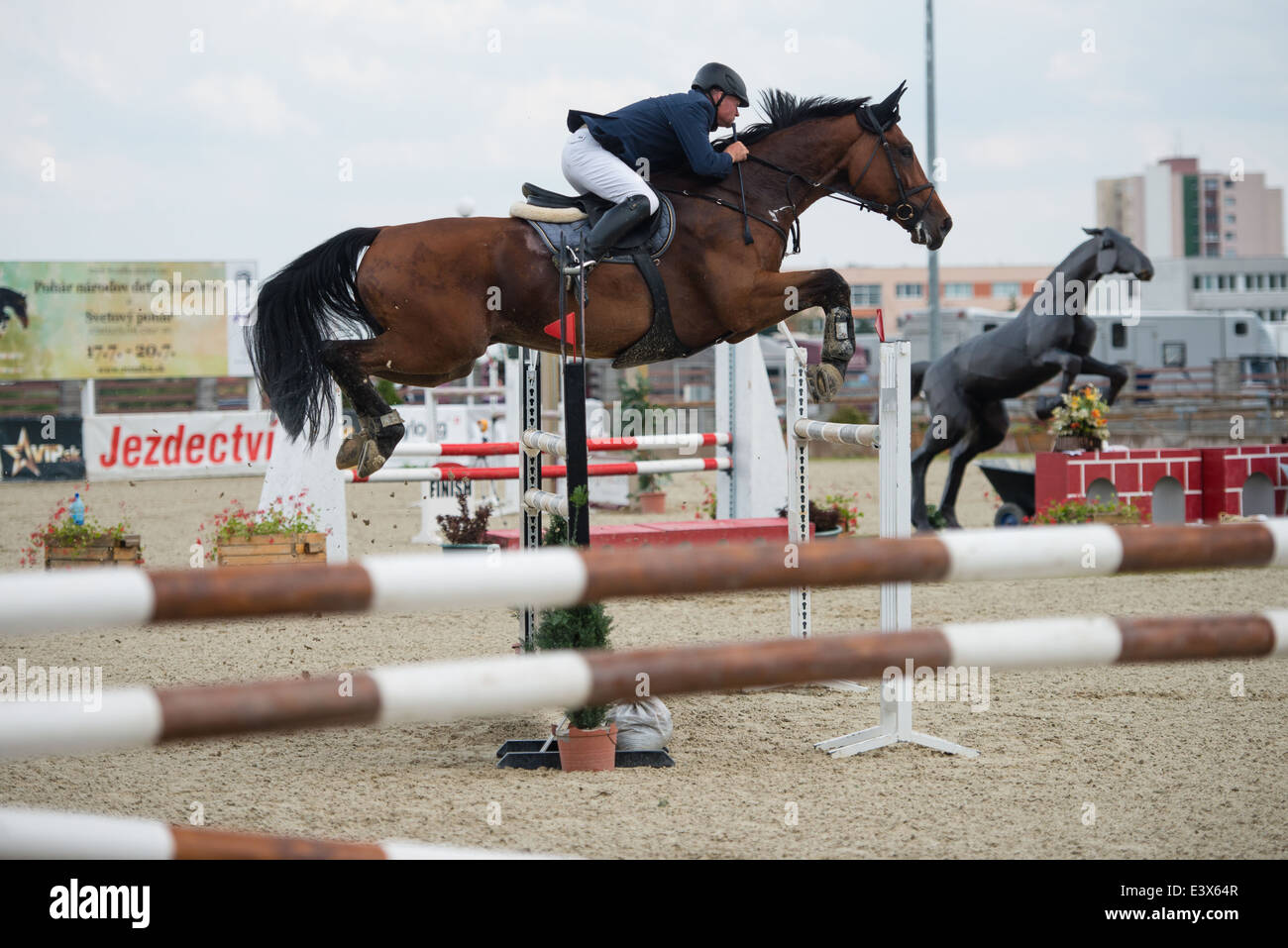 Henrich Mock SVK on horse Jopas jumps over hurdle on Rozalka Cup 2014 on July 29, 2014 in Pezinok, Slovakia - Stock Image