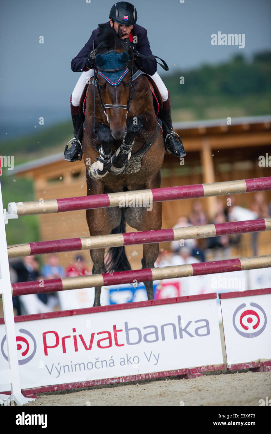 Frantisek Pal on horse Salvatore Von Weich jumps over hurdle on Rozalka Cup 2014 on July 29, 2014 in Pezinok, Slovakia - Stock Image