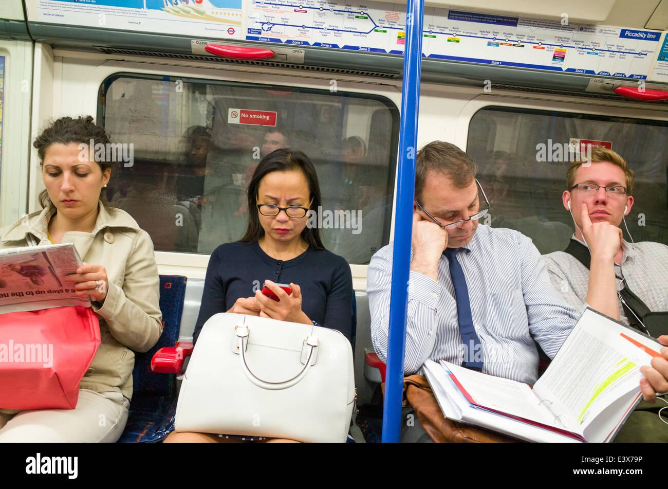 People on the London Underground, UK - Stock Image