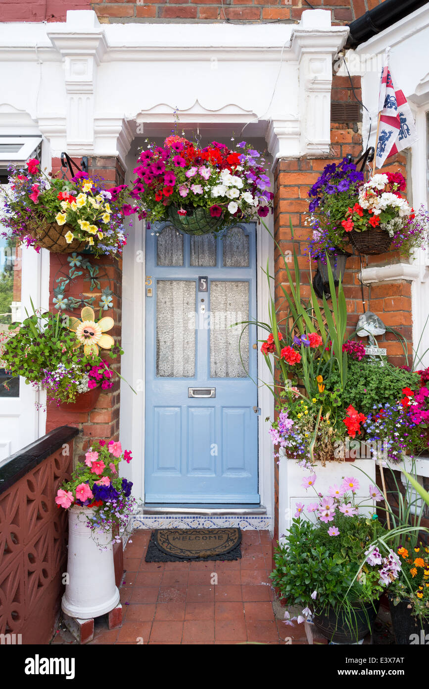 Flowers outside the front door of a terraced house, London
