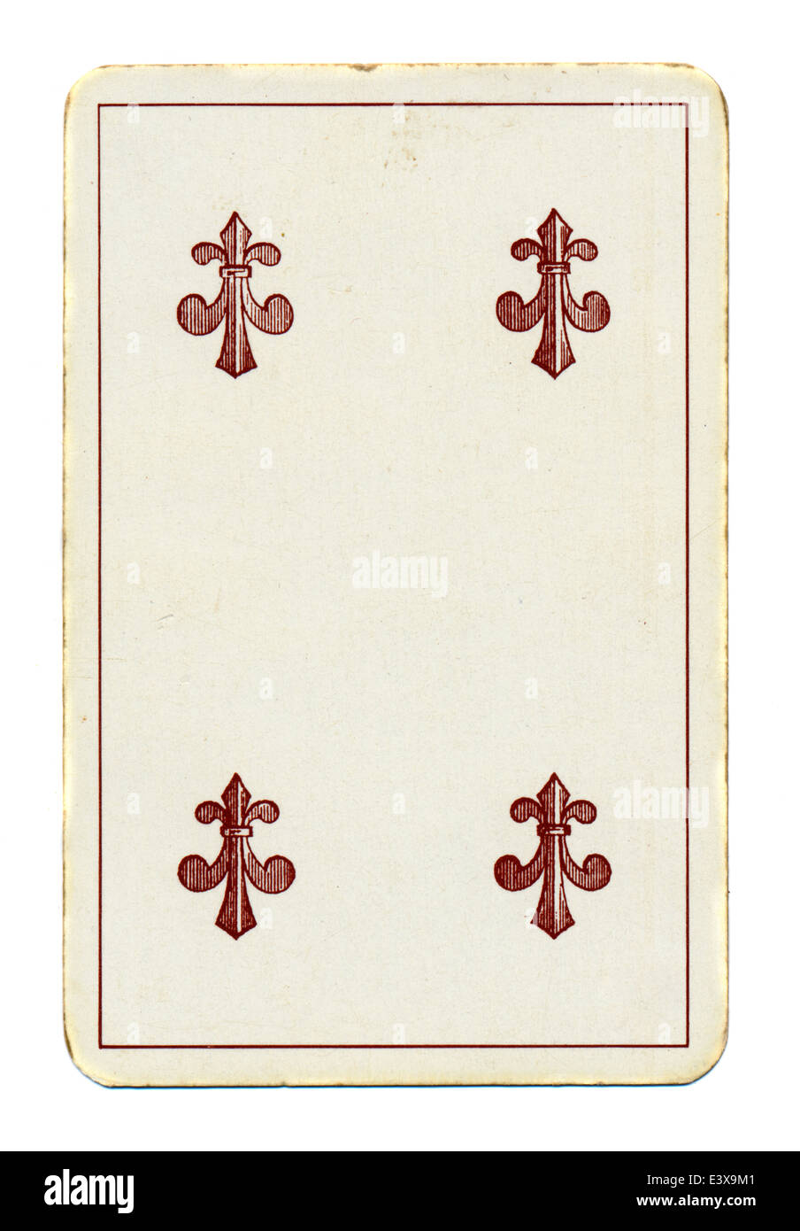 ancient playing card of clubs isolated on white - Stock Image
