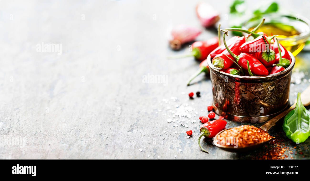 red hot chili peppers with herbs and spices over wooden background stock photo 71264874 alamy. Black Bedroom Furniture Sets. Home Design Ideas