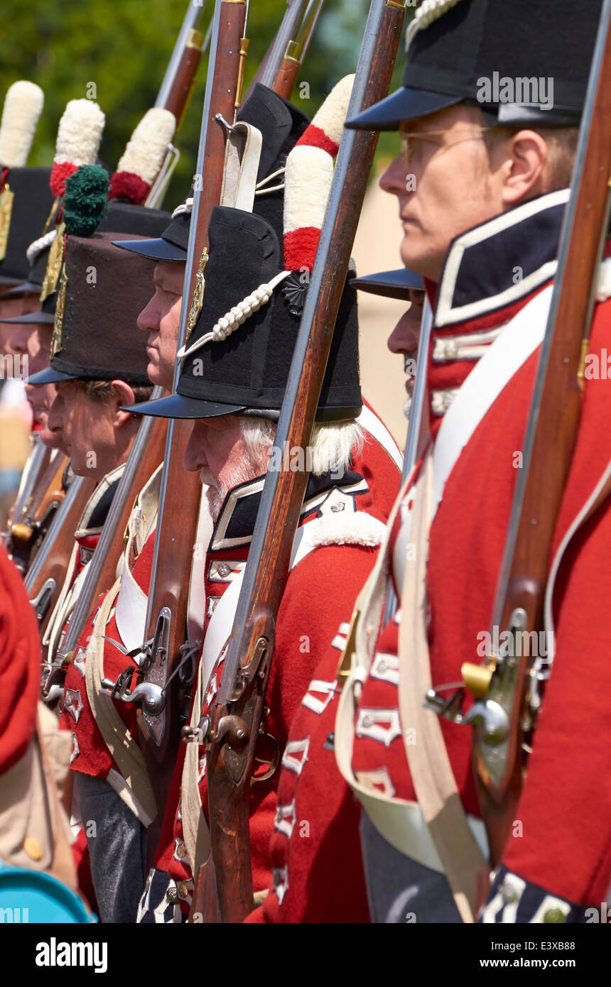 Military re-enactors dressed the Napoleonic Wars uniform of the British Army and carrying 'Brown Bess' flintlock - Stock Image
