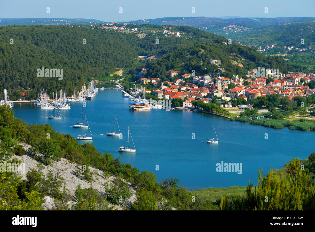 Townscape with sailing ships in the foreground, River Krka, Skradin, Dalmatia, Croatia - Stock Image