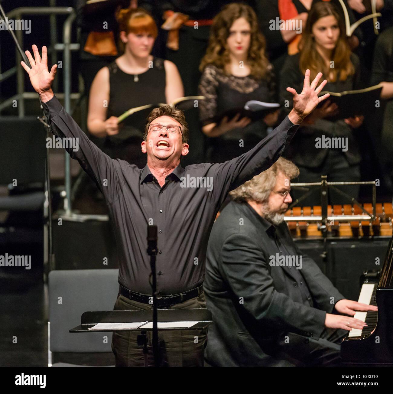 German Baritone Peter Schüler sings in a concert. - Stock Image