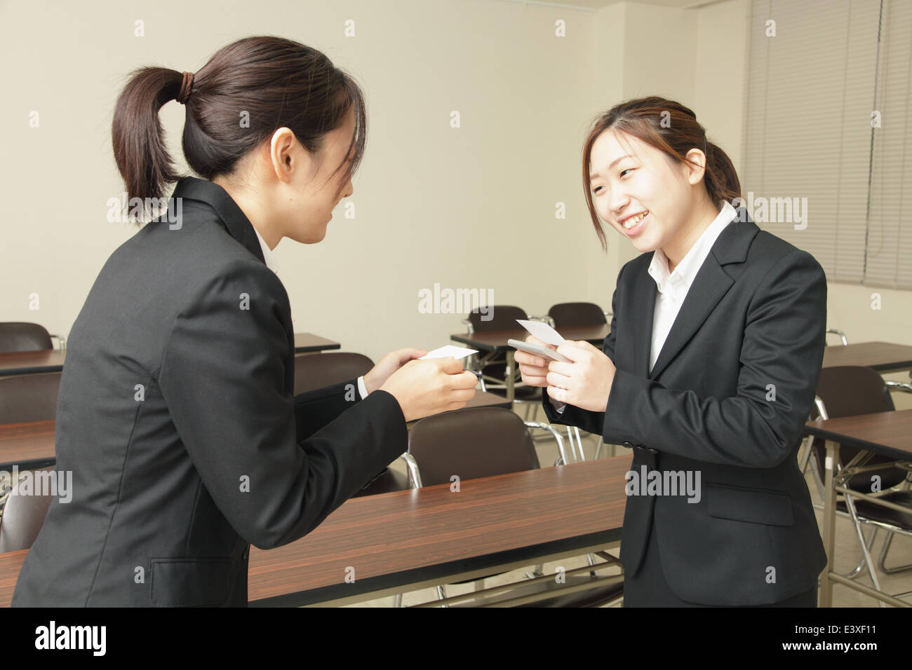 Japanese business people exchanging business cards stock photo japanese business people exchanging business cards reheart Gallery