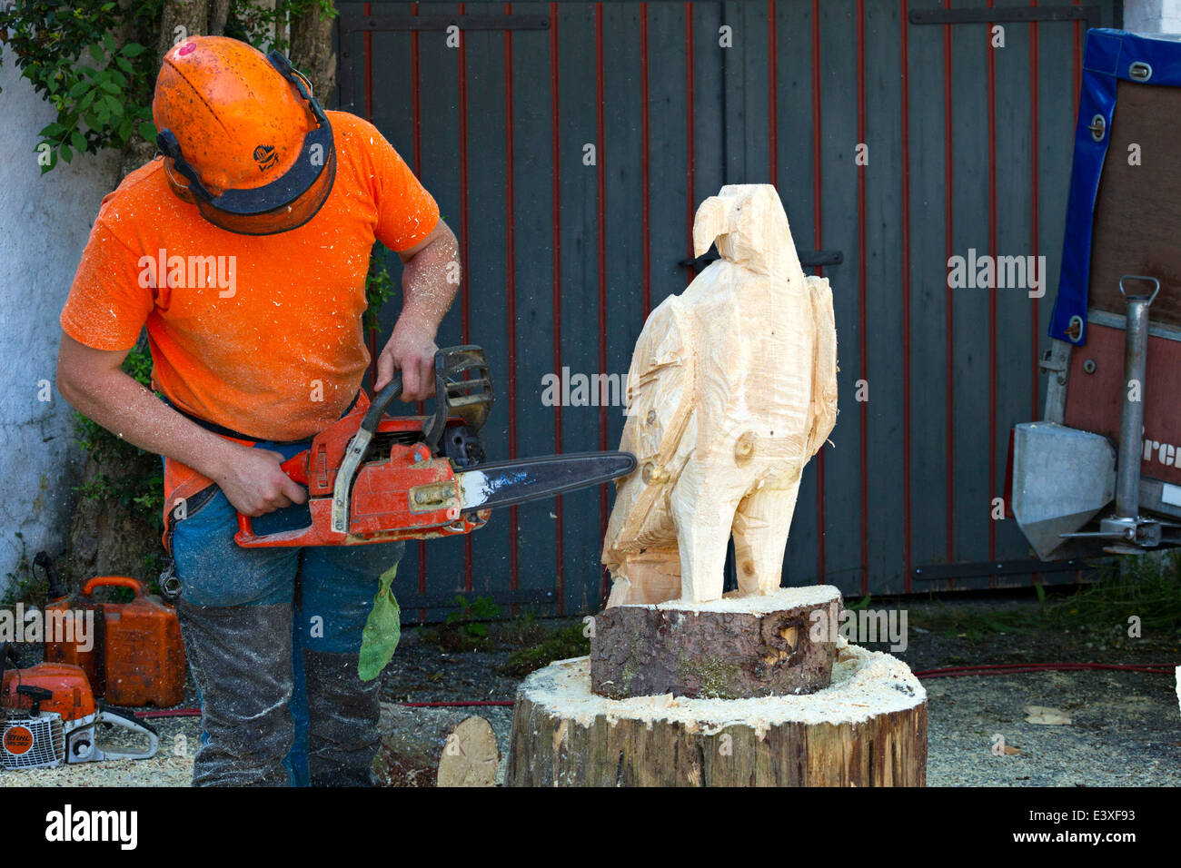 Chain saw wood carving stock photos