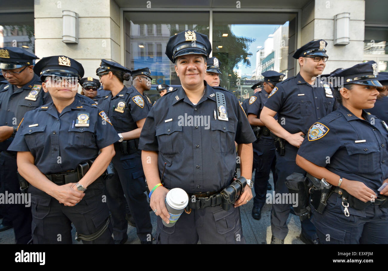 A group of policemen and policewomen await instruction before the Gay Pride Parade in New York City. - Stock Image