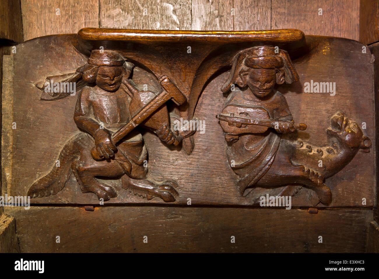 UK England, Suffolk, Lavenham, Parish Church, half man half beast musicians misericord - Stock Image