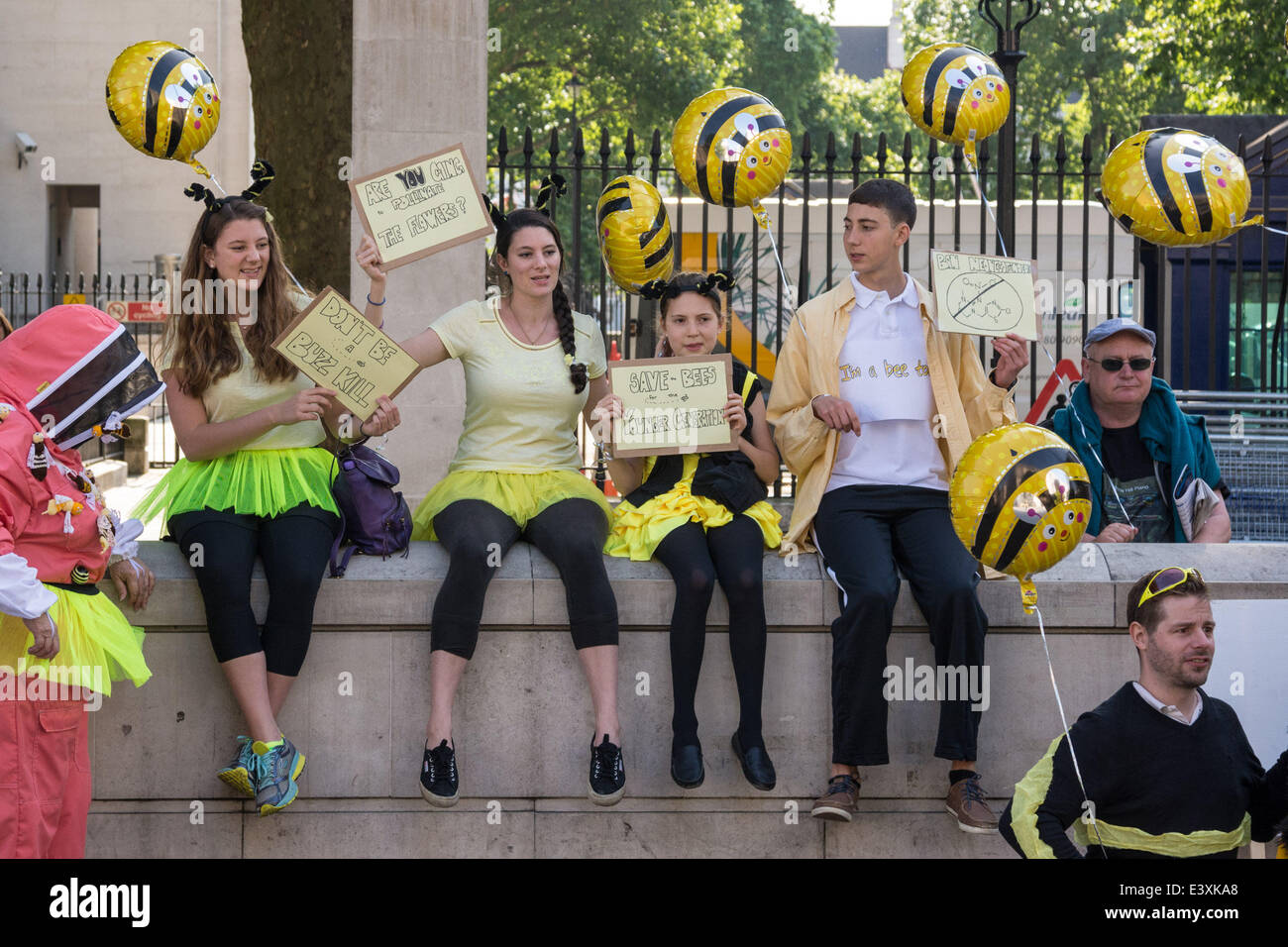 Whitehall, London, UK. 1st July 2014. Protesters in yellow and black swarm opposite the entrance to Downing Street - Stock Image