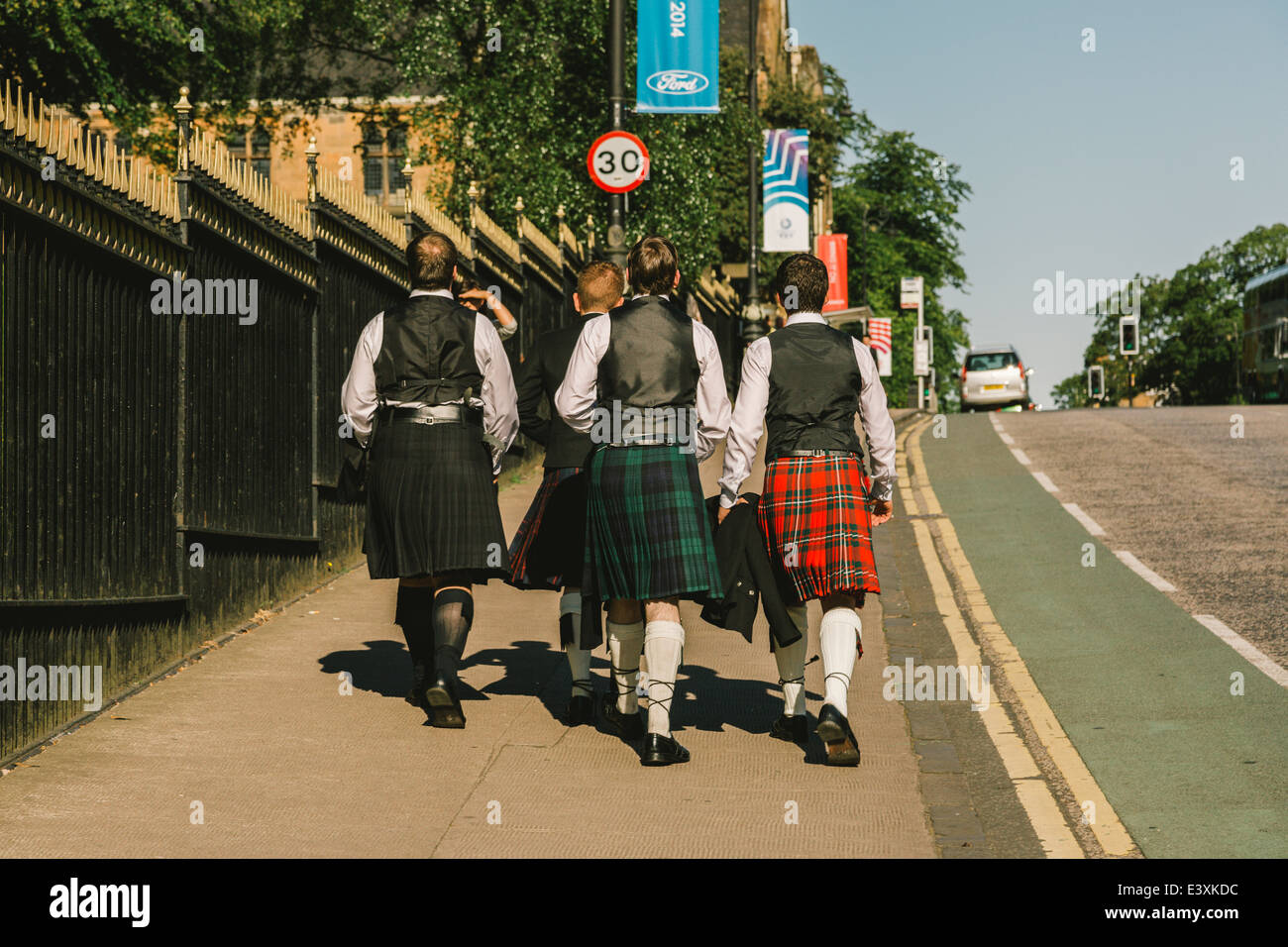 A group of young scottish students wearing kilt dress walking to Glasgow University for graduation day, Glasgow, - Stock Image