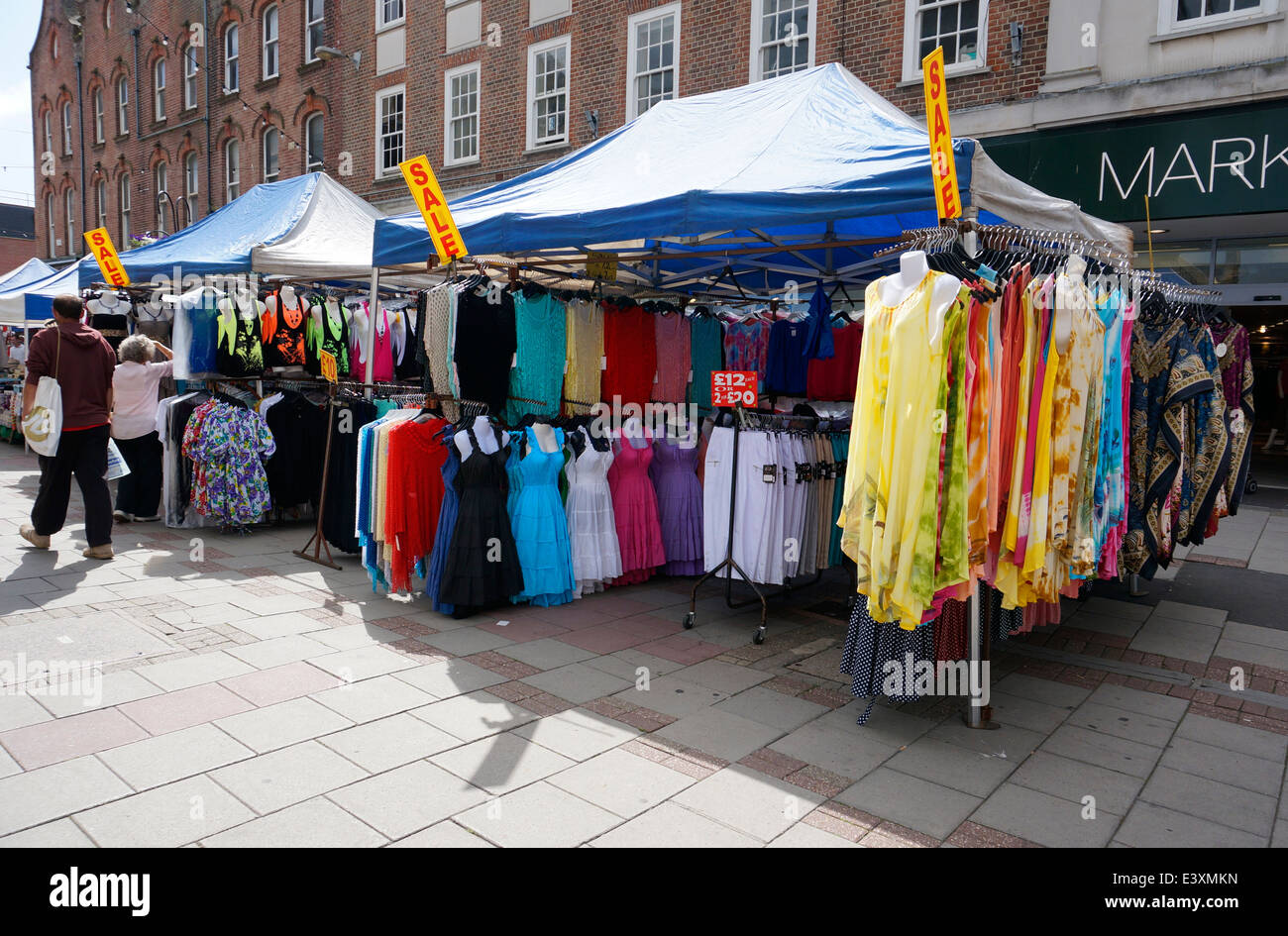 A market stall selling a selection of clothes dresses & cardigans in Worthing precinct pedestrianised area West - Stock Image