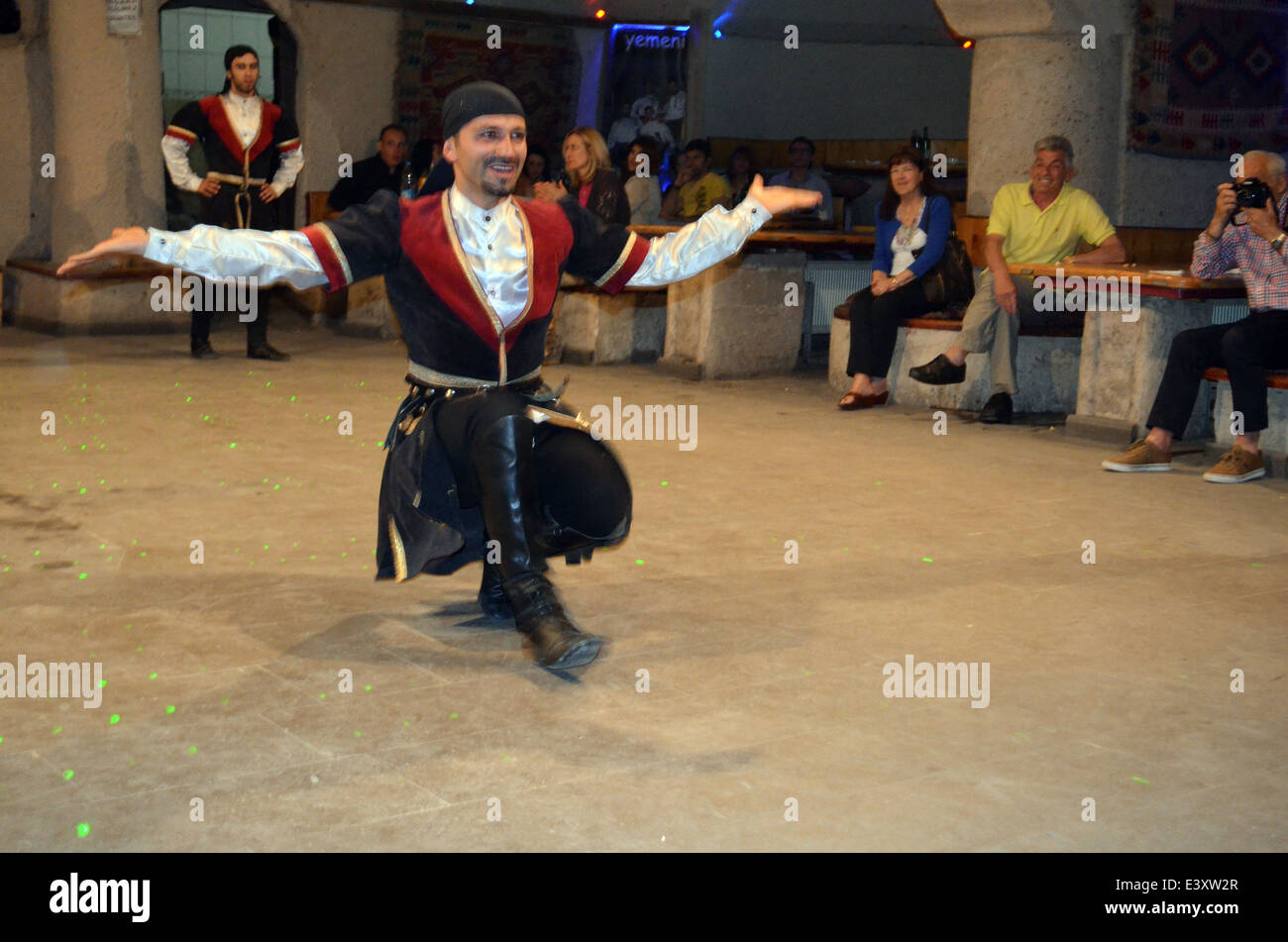 An evening of dancingand entertainment after visiting thefairy tale houses &churches of Cappadocia.They are - Stock Image