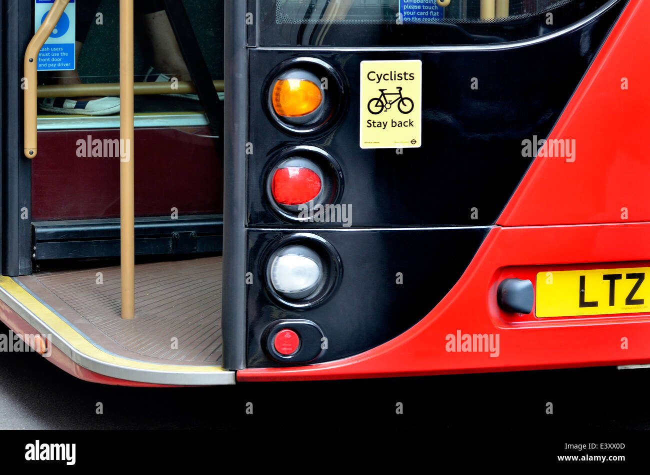 London, England, UK. New Routemaster Red London bus. Open back and warning to cyclists - Stock Image