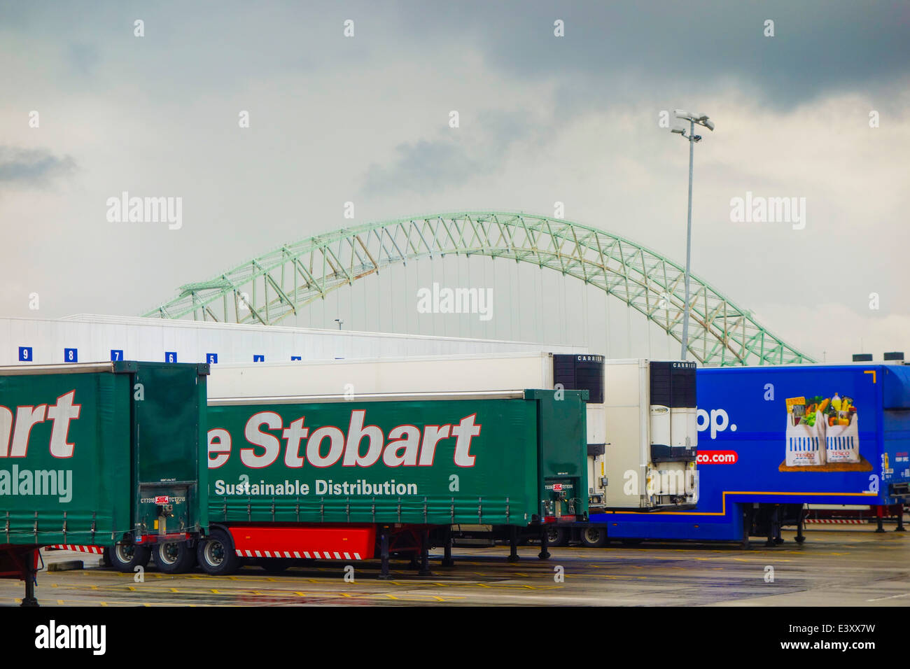Eddie Stobart trailers parked up at Tesco distribution centre at Widnes. - Stock Image