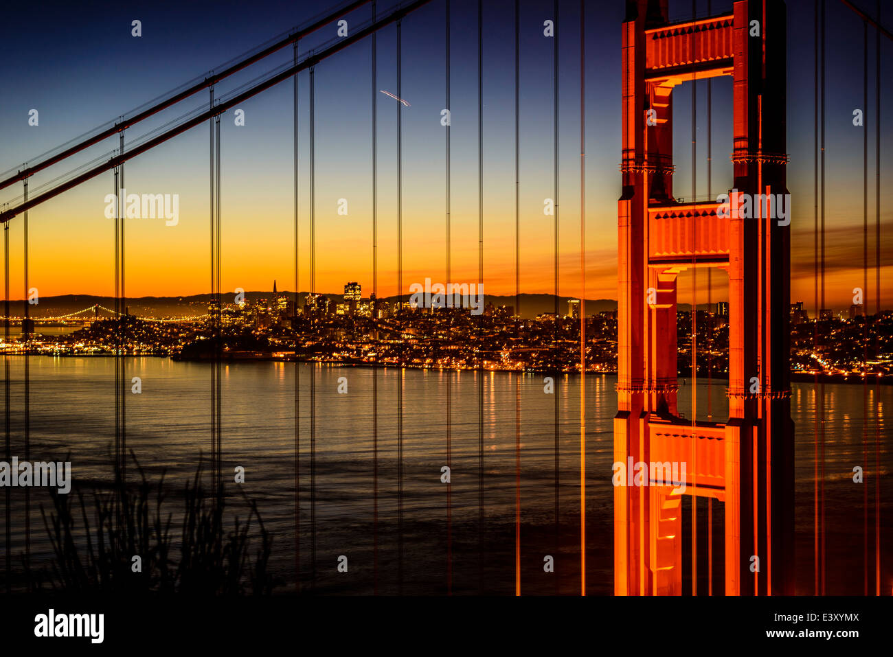Golden Gate Bridge and San Francisco skyline lit up at night, San Francisco, California, United States Stock Photo