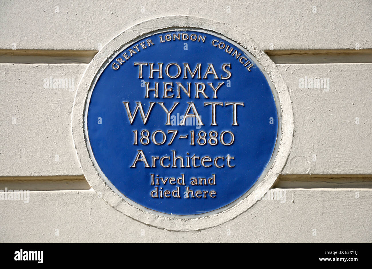 London, England, UK. Blue Plaque at former home of architect Thomas Henry Wyatt at 77 Great Russell Street, Camden, - Stock Image