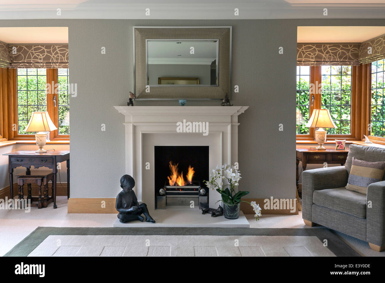Fireplace and armchair living room - Stock Image