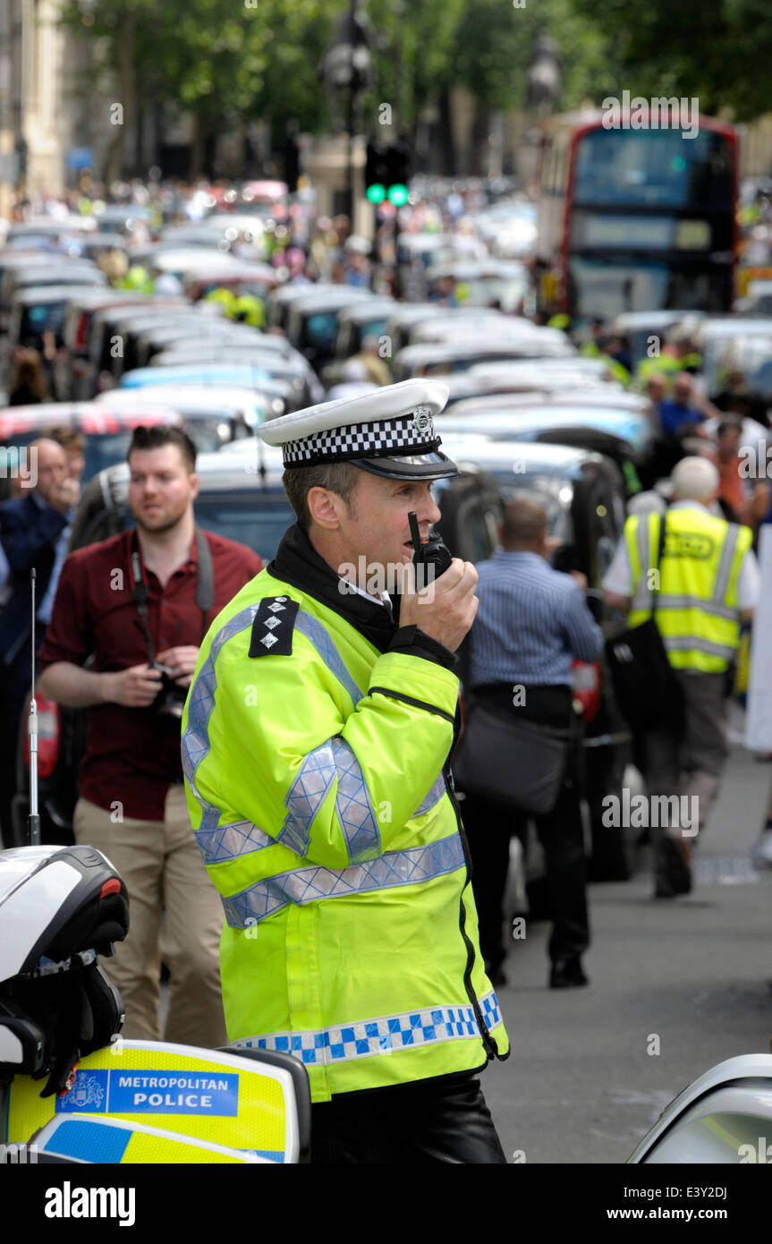 London, England, UK. Metropolitan police officers on duty during a taxi drivers' protest in central London, June Stock Photo