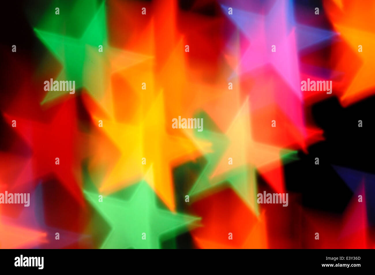 Falling stars abstract lights motion blur. Colorful festive background. Stock Photo