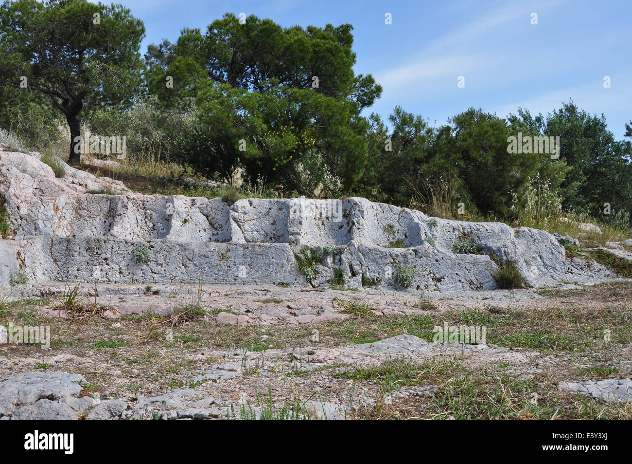 Eptathronon seven thrones plateau ancient greek ruins on Philopappos hill. Rock hewn seats. - Stock Image