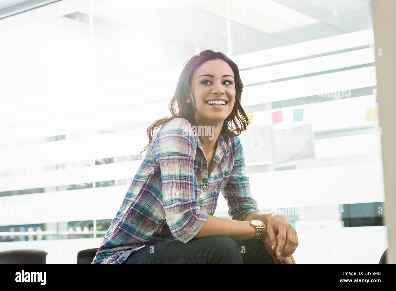 Portrait of confident young businesswoman in office - Stock Image