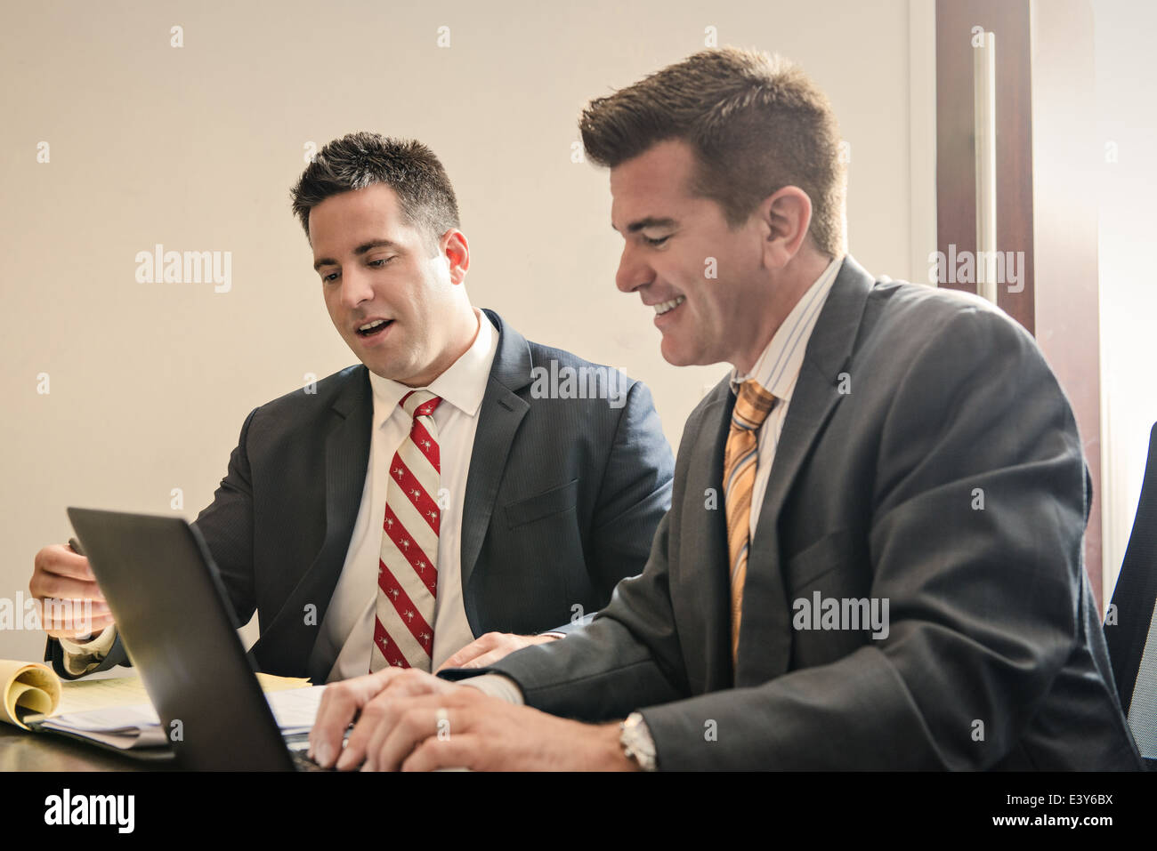 Two male business lawyers having a planning meeting in office - Stock Image