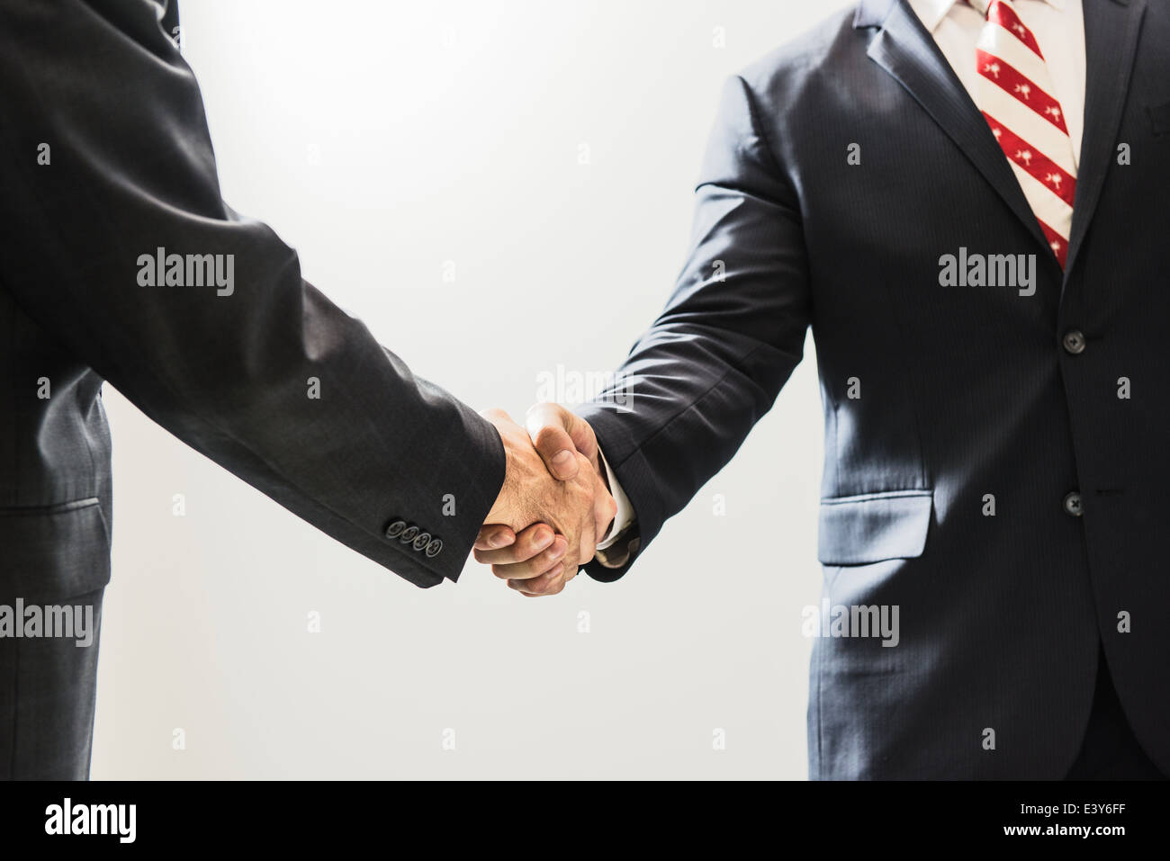 Cropped shot of male business lawyers shaking hands in office Stock Photo