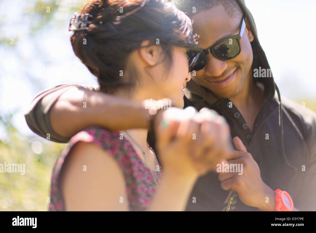 Close up of romantic young couple holding hands Stock Photo