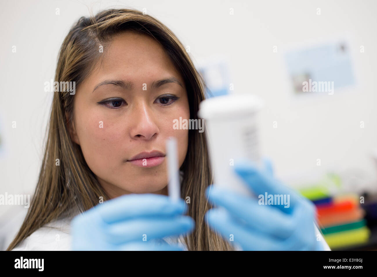 Science student holding litmus paper - Stock Image