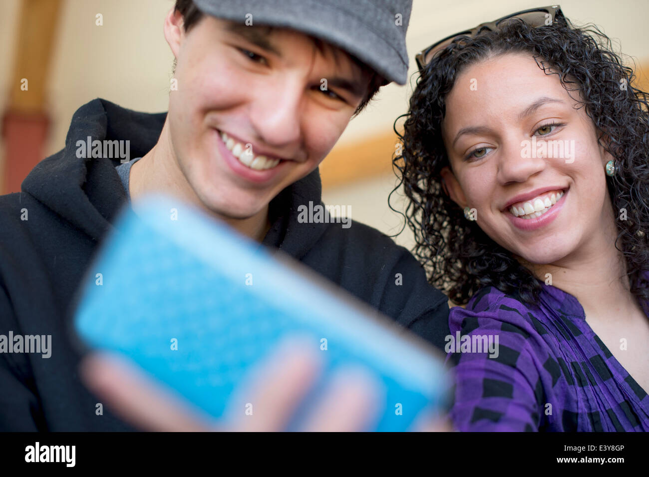 Young couple photographing themselves - Stock Image