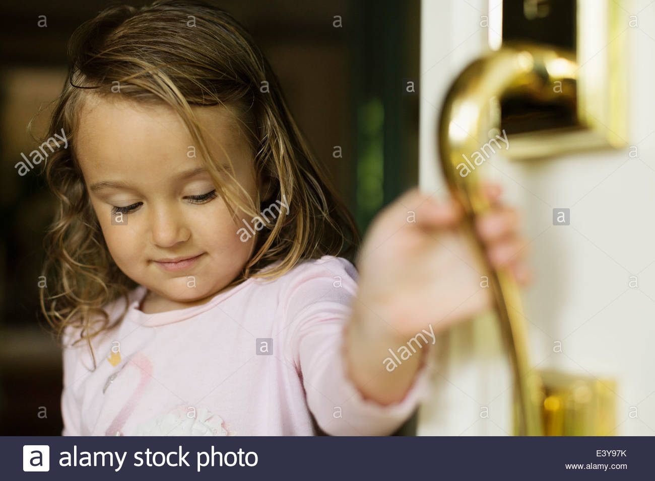 Female toddler opening door - Stock Image