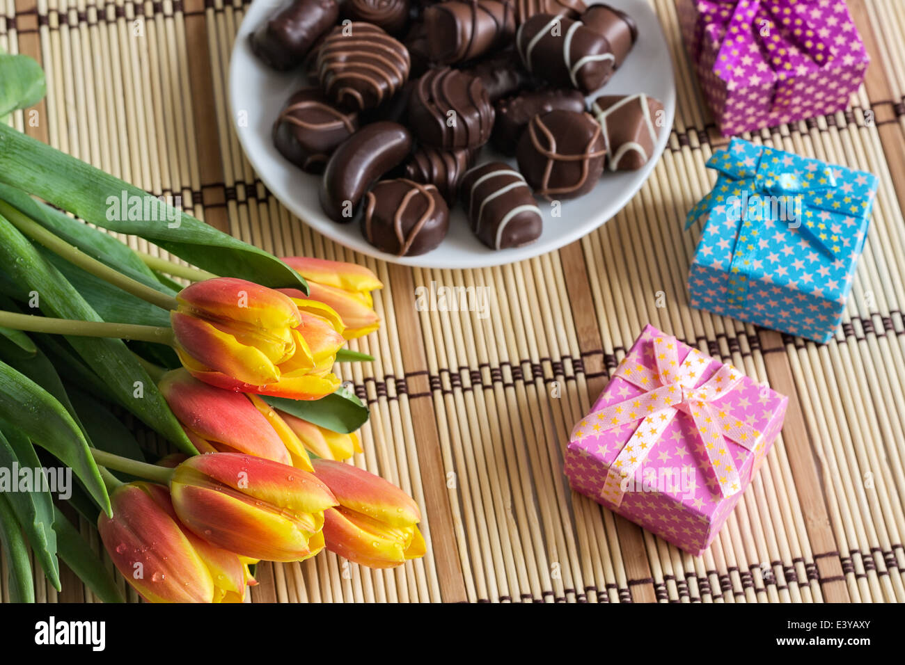 Bouquet Of Tulips Chocolate Candies And Small Gift Boxes Selective