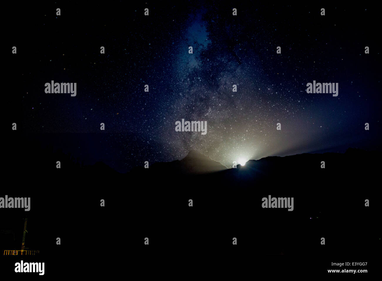 Moonrise at the Himalayas with the Milky way in the star-filled sky - Stock Image