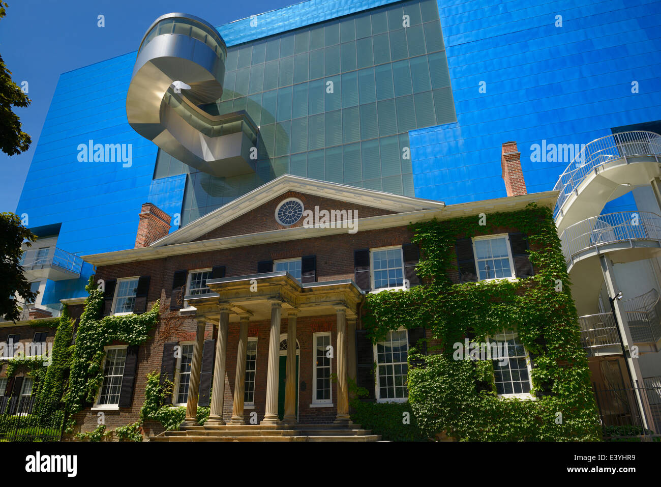 South wing of the blue titanium Ontario Art Gallery designed by Gehry over the historic Grange manor Toronto - Stock Image