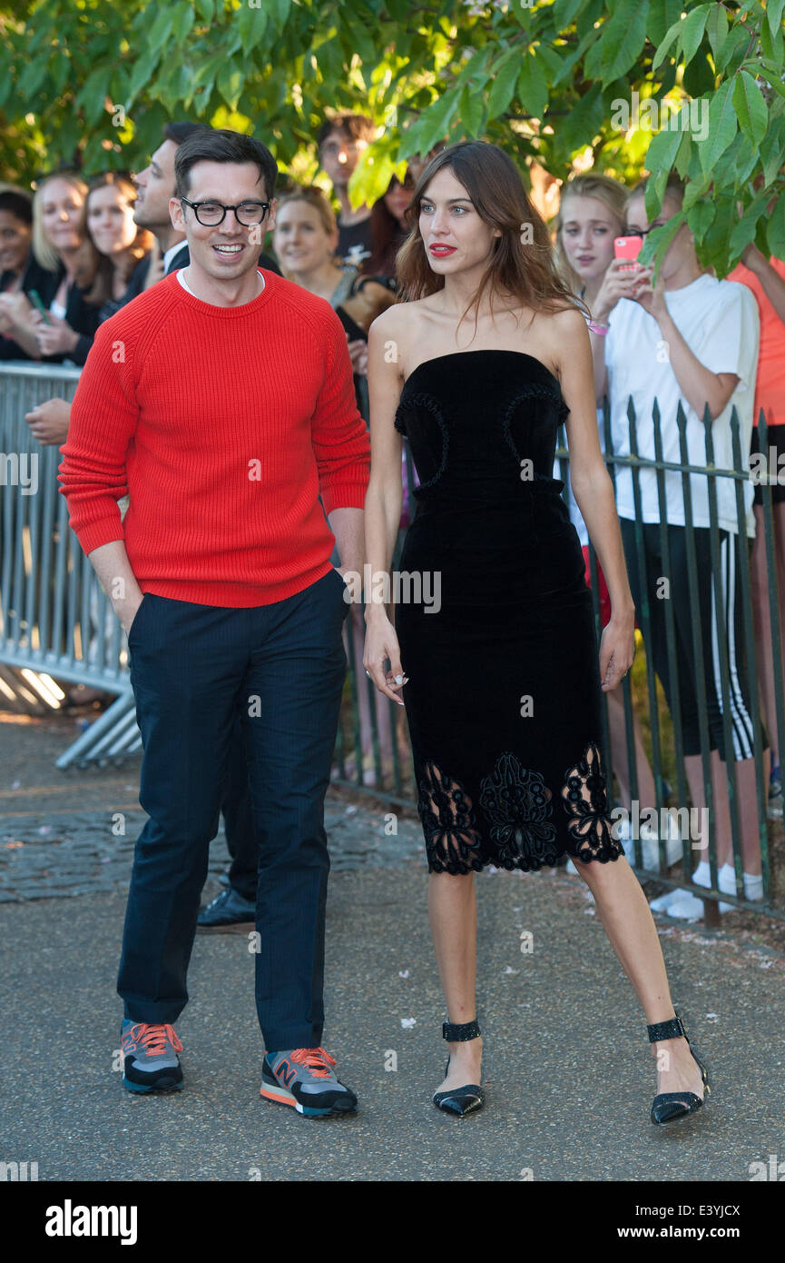 London, UK. 1st July 2014. Fashion designer Erdem Moralioglu (L) and presenter Alexa Chung (R) arrives at the Serpentine - Stock Image