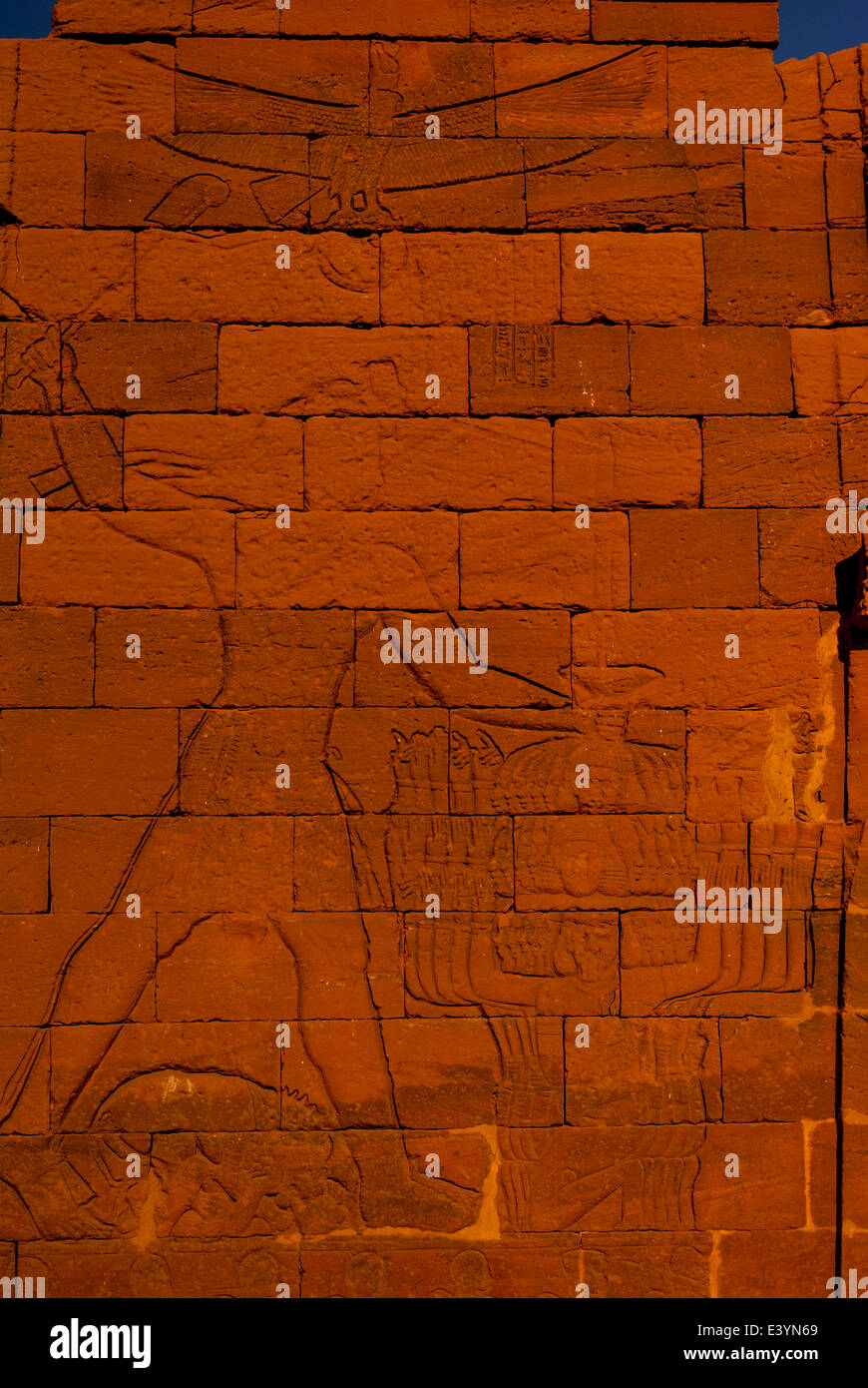 King Natakamani smiting his enemies - relief on left pylon of Lion (Apademak) Temple, Naqa, northern Sudan - Stock Image