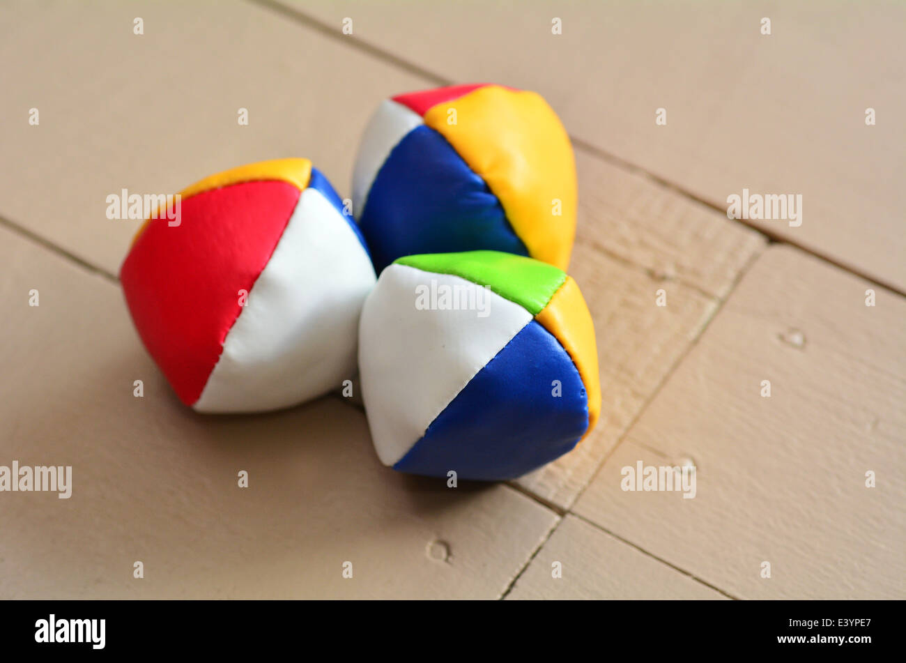 Set of three (3) Juggling balls on a wooden floor. concept photo, copy space - Stock Image