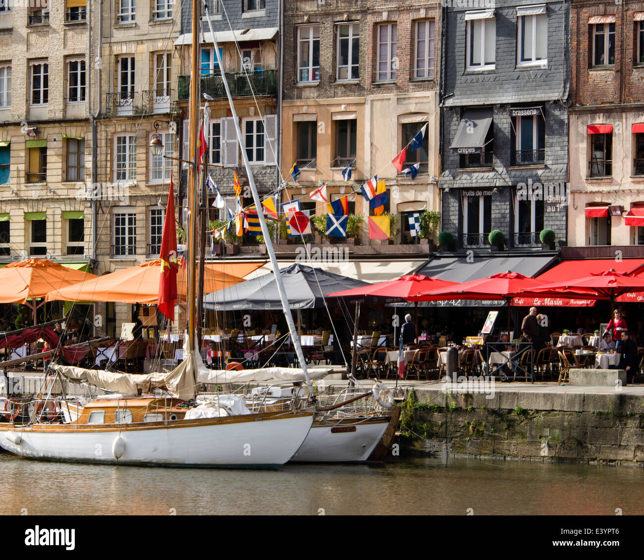 Sailboats docked along Vieux Bassin in front of bars and cafes along Quai Ste. Catherine, Honfleur, Normandy, France Stock Photo