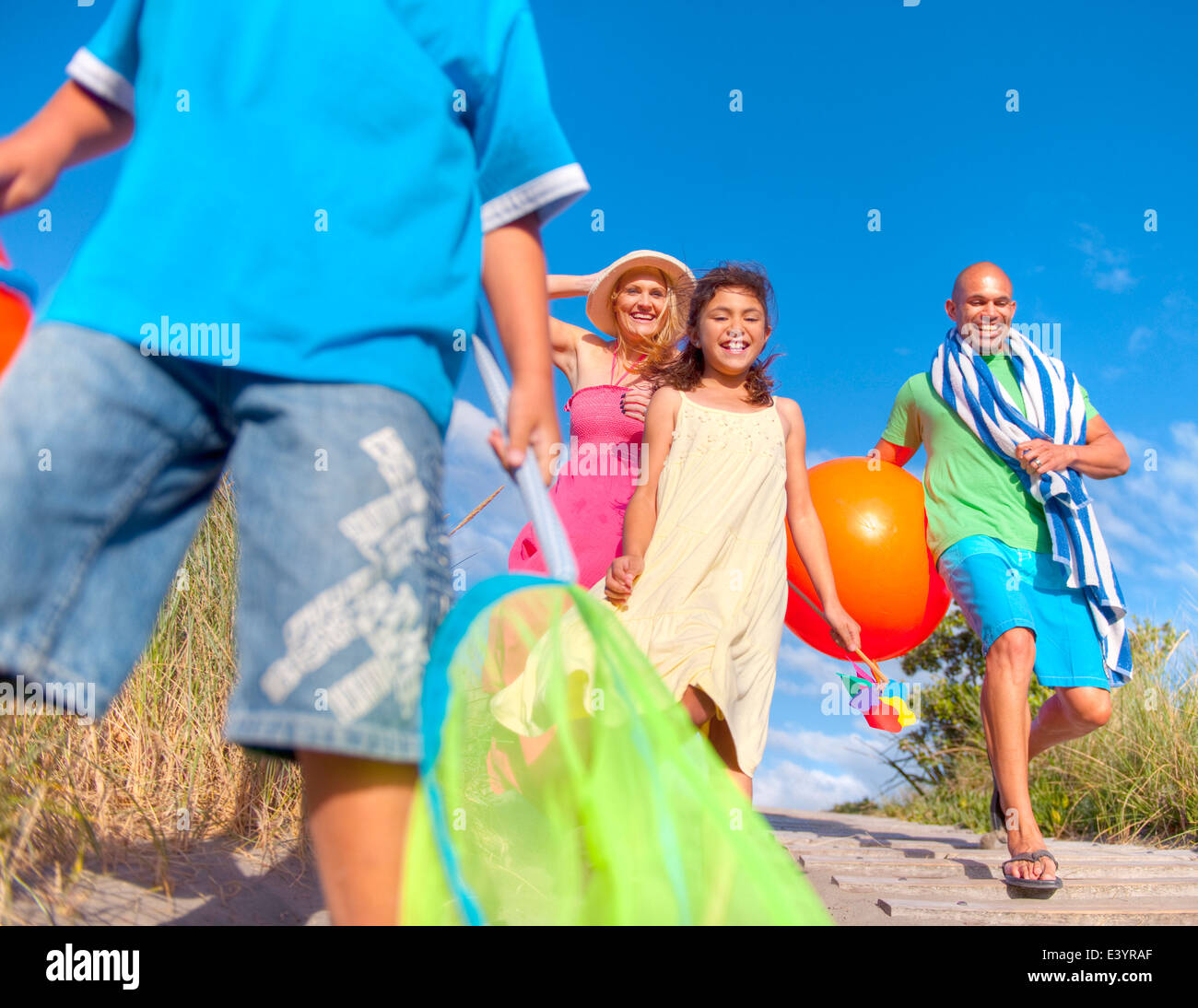 Cheerful Family Going To The Beach