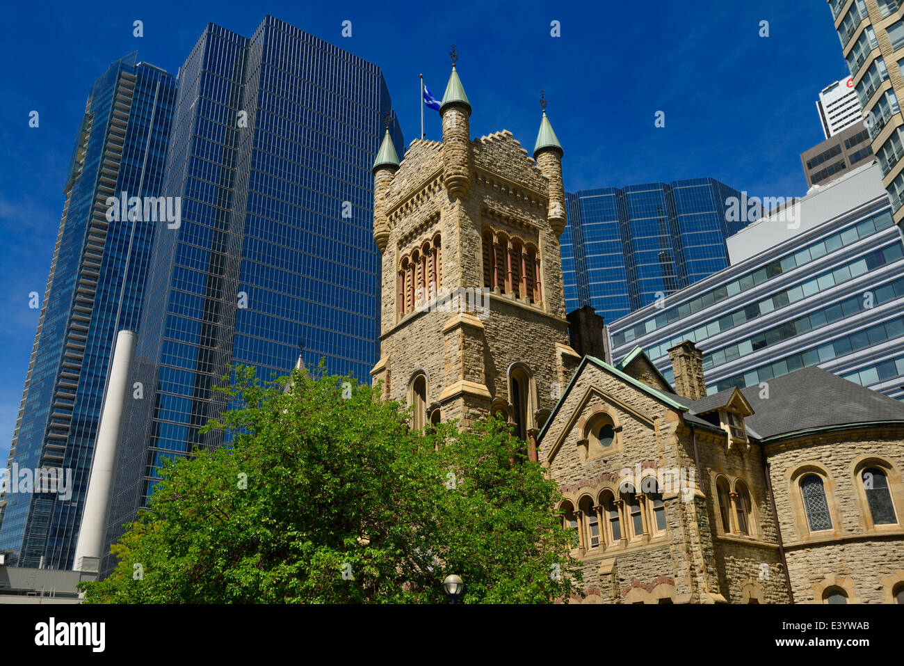 Old St Andrews presbyterian church against modern glass highrise office towers in Toronto - Stock Image