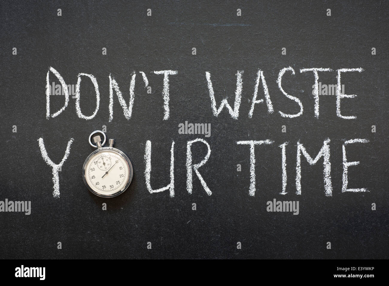 dont waste your time phrase handwritten on chalkboard vintage precise stopwatch used instead of O - Stock Image