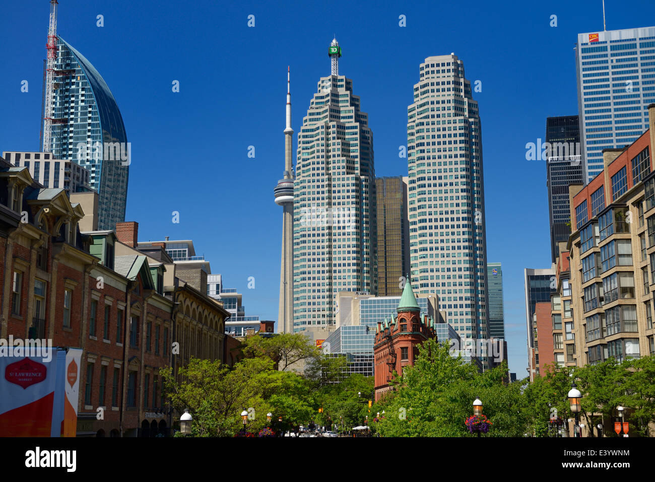 Gooderham Flatiron building with financial district bank towers L tower and CN tower at St Lawrence Market Toronto - Stock Image