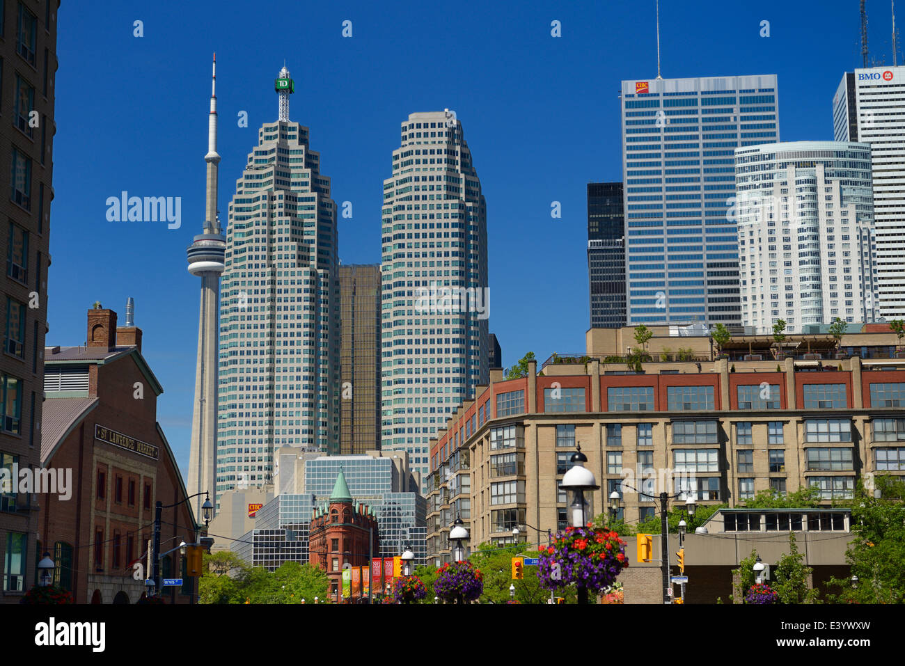 St Lawrence Market and Gooderham Flatiron building with financial district bank towers and CN tower Toronto in summer - Stock Image