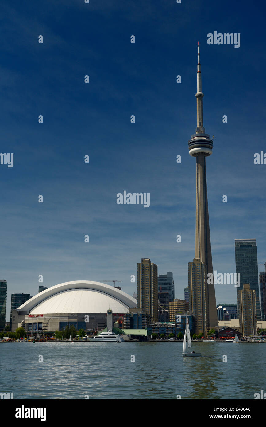Toronto skyline with Rogers Centre and CN Tower and sailboats on Lake Ontario - Stock Image