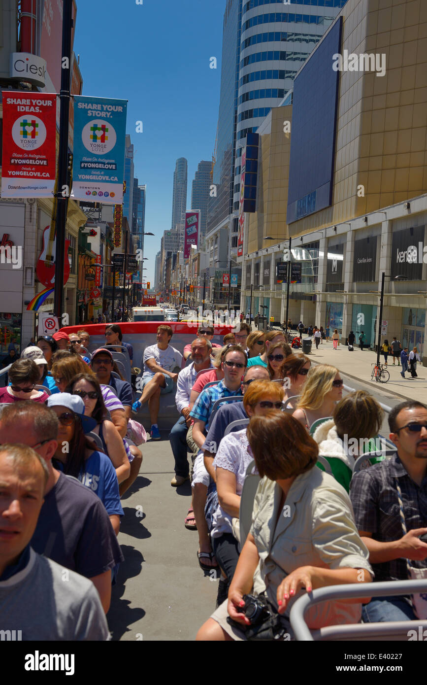 Downtown Toronto Yonge Street at Eaton Centre from the top of an open double decker tour bus with tourists in summer - Stock Image