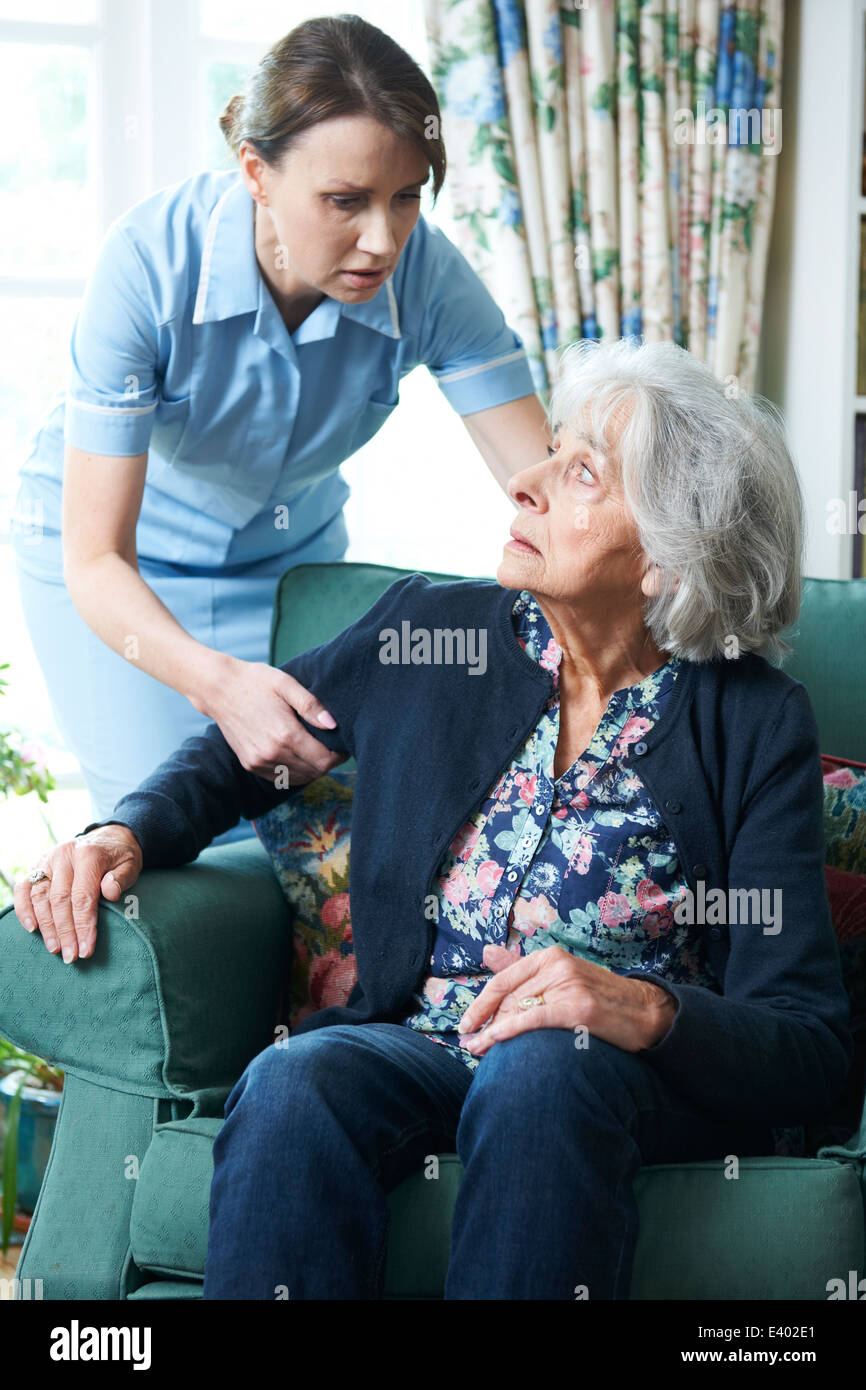 Care Worker Mistreating Senior Woman - Stock Image
